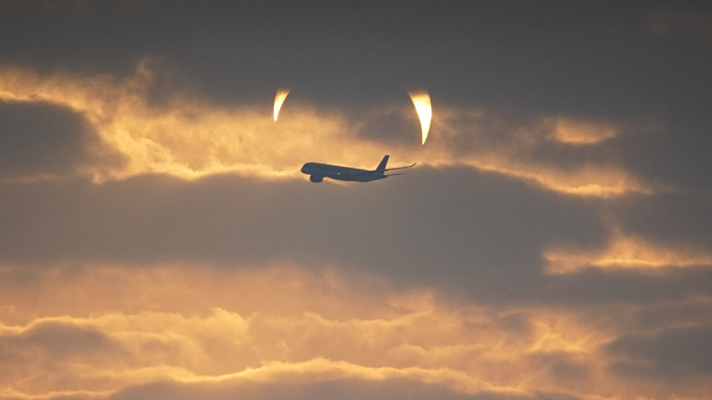 An annular solar eclipse, partially hidden by clouds, as seen in Al Wakrah, Qatar, Dec. 26, 2019.