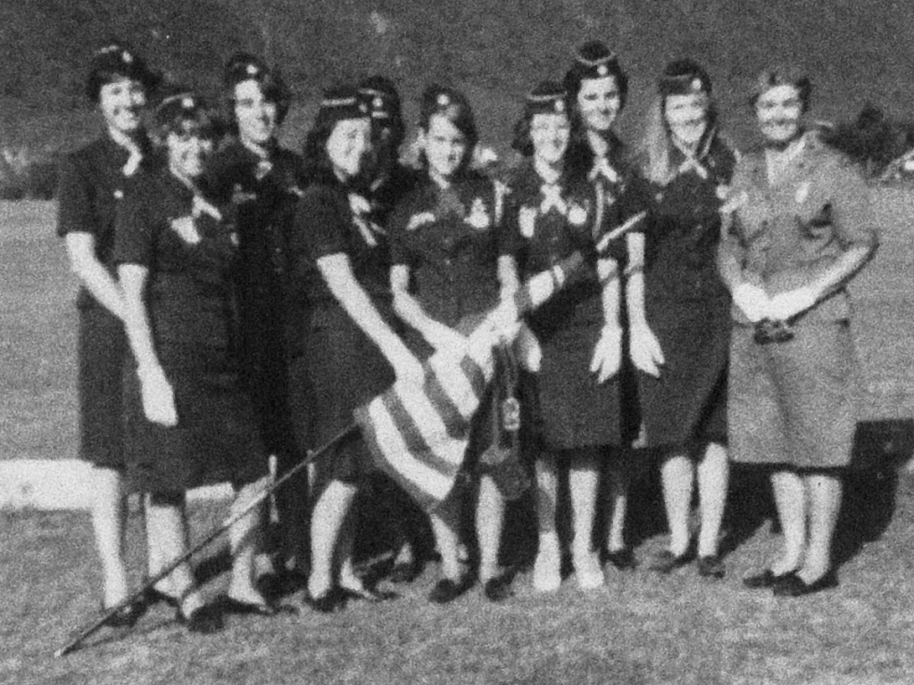 Ronnie Backenstoe in a photo with other members of the Girl Scouts. Backenstoe has sold cookies since she was 10.